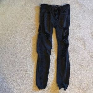 Black super stretch AE jeans with rips